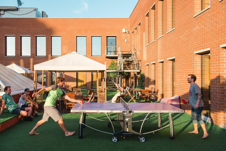 Students play ping pong at Codeworks